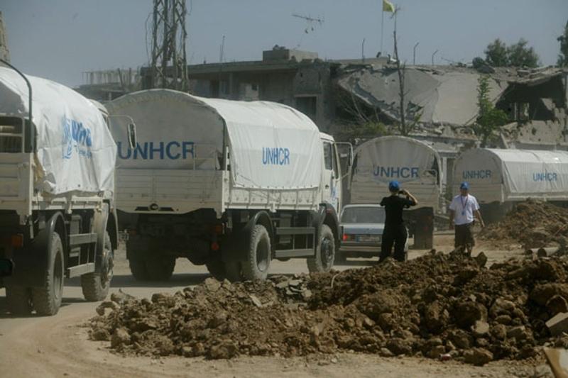 Un convoi de camions du HCR. Crédits : HCR.
